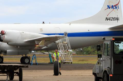 NASA P-3B crewman moves apre equipment into STP hangar.
